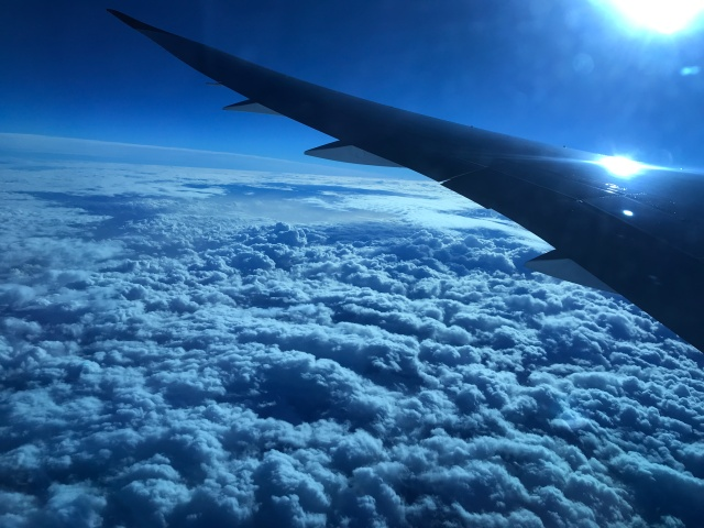 Plane wing and clouds